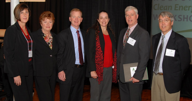 The workshop featured municipal, state, and federal perspectives on issues that impact development of an effective test-bed environment. From left to right: Kathleen Anderson (Director of Planning and Economic Development, City of Holyoke), Mayor Elaine Pluta (City of Holyoke), James Lavelle (Workshop Co-chair, Manager, Holyoke Gas & Electric), Patricia Hoffman (Assistant Secretary, Office of Electricity Delivery and Energy Reliability, U.S. Department of Energy (DOE), Richard Sullivan (Secretary, Massachusetts Executive Office of Energy and Environmental Affairs), and Jim Kurose (Workshop Co-chair, Distinguished Professor of Computer Science, University of Massachusetts) - Image: masstech.org