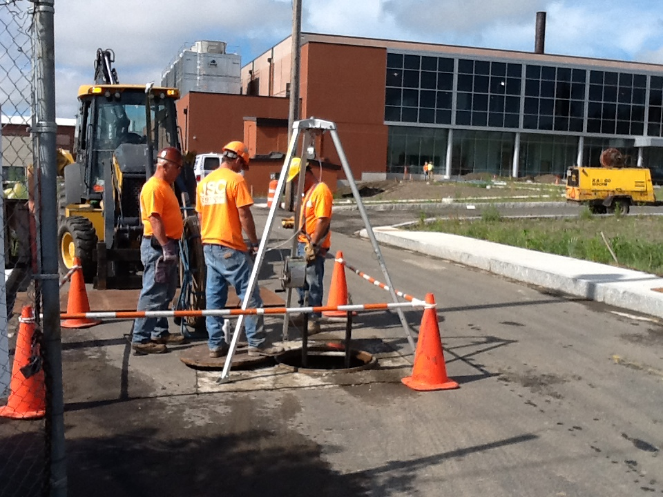 HG&E workers installing optical fiber in the conduit beneath Bigelow Street near the data center - Aug 15
