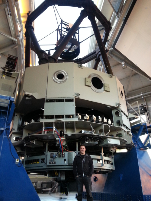 Veyette standing beside the Discovery Channel Telescope, Lowell Observatory, AZ - image courtesy: M. Veyette